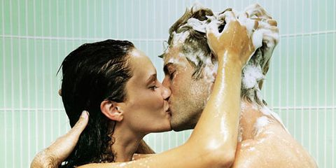 hombre and woman soapy and kissing in the shower