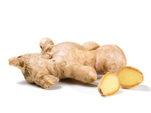 ए ginger root with fresh ginger slices on white background