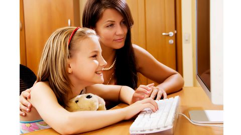 Mama helping child on computer
