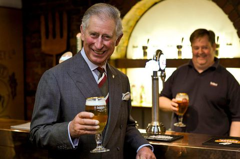 Prins Charles drinking a pint of beer